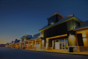 shopping center with outdoor lighting at twilight
